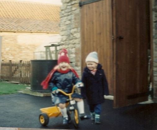 Me stealing my little brother's yellow tricycle
